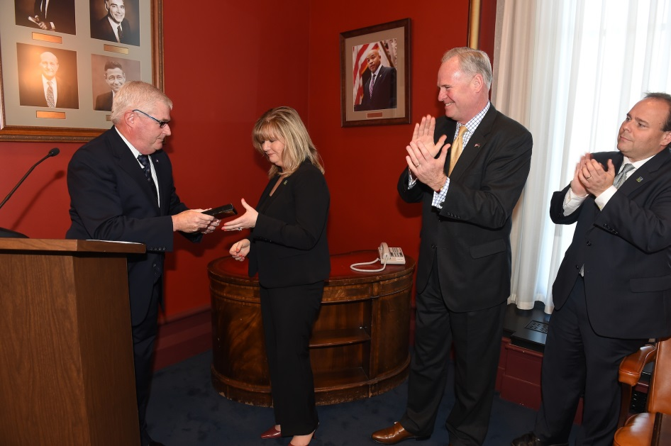Assembly Minority Leader Brian M. Kolb (R,C-Canandaigua) and Assemblymen Michael Fitzpatrick (R,C,I-Smithtown) and Phil Palmesano (R,C,I-Corning) present Kathy Albrecht with the New York State Gift of
