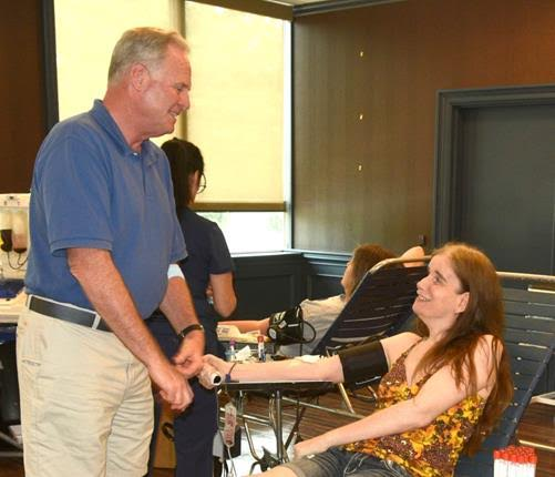 Assemblyman Michael Fitzpatrick (R,C,I-Smithtown), who also gave blood, greets local resident Kristy Conn as she gives a blood donation at his drive in Hauppauge.