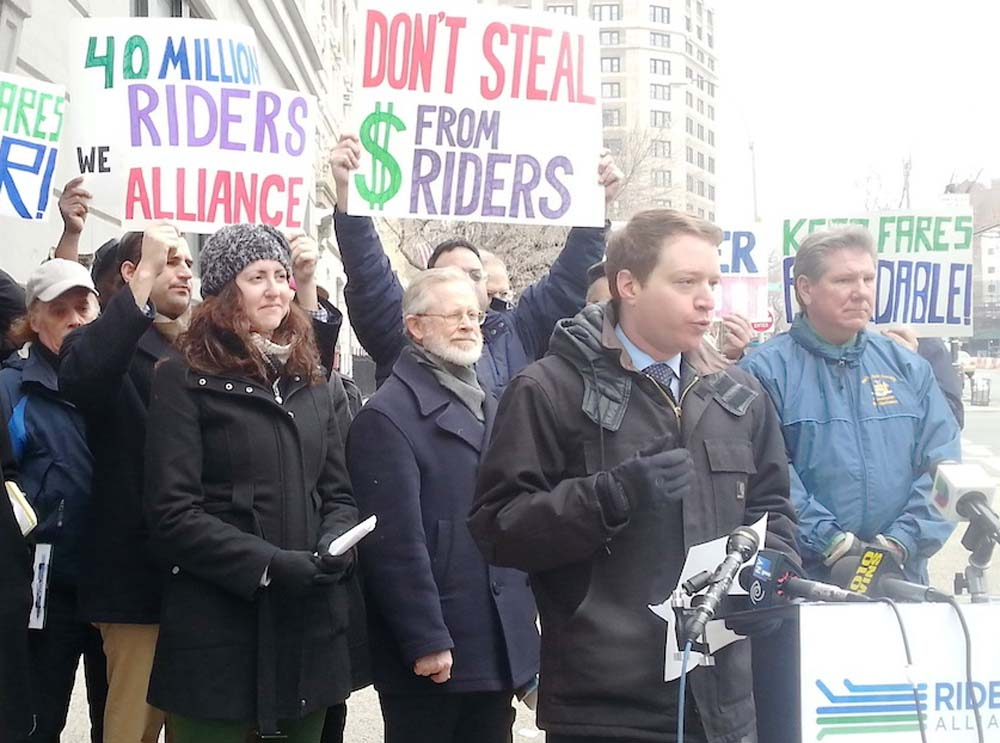 Assemblywoman Nily Rozic joined Riders Alliance and transit advocates to call on the MTA to invest a $40 million unexpected surplus in restoring and expanding transit service.