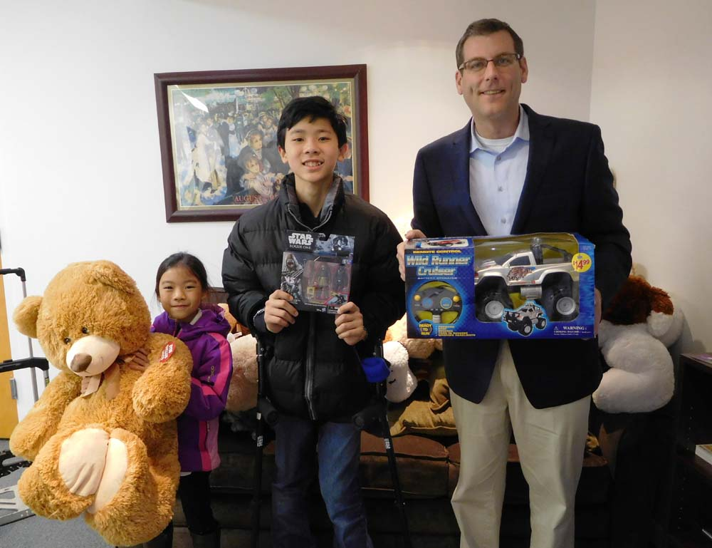 Assemblyman Braunstein is pictured with Madison and Maximus Wong from PS 107, whose school donated to Assemblyman Braunstein's 7th Annual Toy Drive.