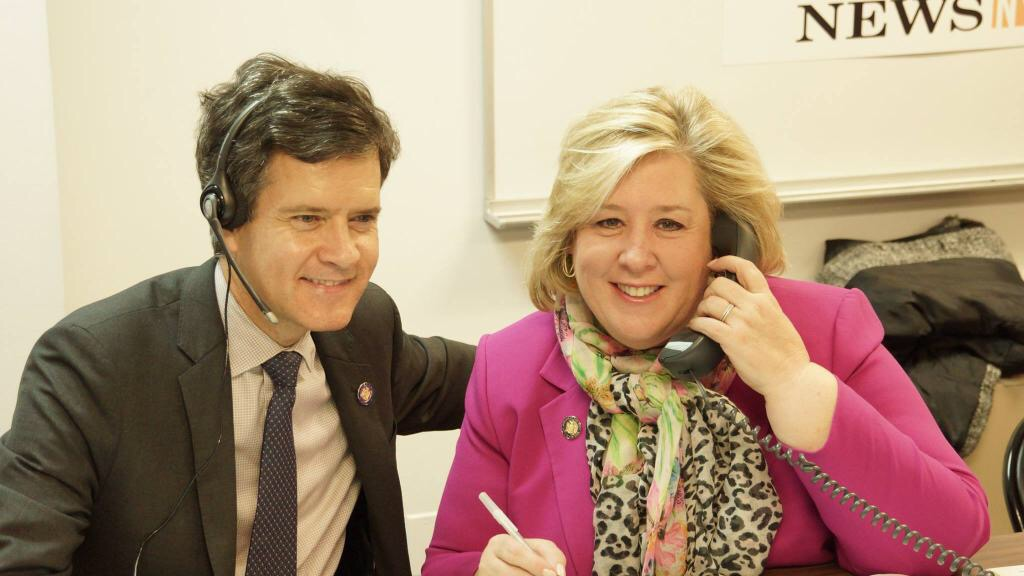 May 1, 2015—New York, NY—Assembly Member Seawright takes calls at the CUNY Citizenship Now! Daily News call center with State Senator Brad Hoylman.