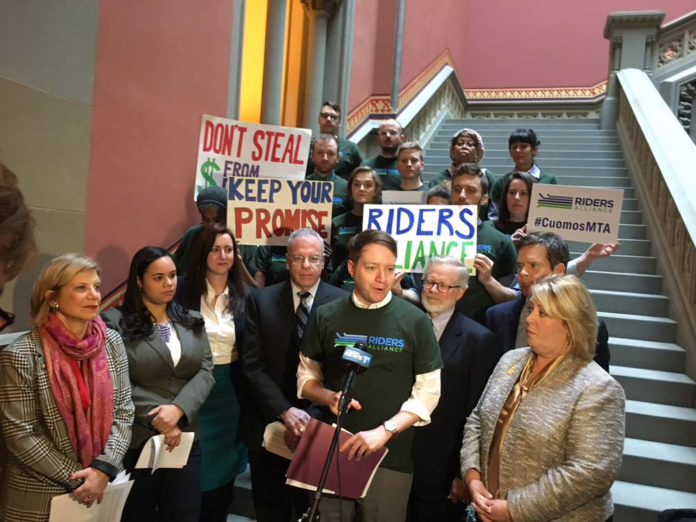 Feb 13, 2017 – Assembly Member Seawright along with Riders Alliance Executive Director John Raskin and her assembly colleagues at a press conference demanding restoration of the $65 million of promised funds to the MTA. The Riders Alliance called on Governor Cuomo to reverse his proposal to cut $65 million of promised funding to the MTA. Originally, Governor Cuomo promised to fully reimburse the MTA with missing funds every year as far back as 2011. However, this year he proposed to return only $244 million, which would leave the MTA with a $65 million gap. Taking away promised funding from transit riders has caused delays to triple in just four years. Governor Cuomo's proposal to break his longstanding promise to transit riders deprives the MTA of much needed funds for an effective and reliable NYC transit system. The money is needed to run more subways and buses to accommodate New York's growing population.<br />