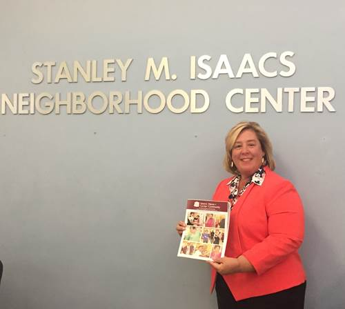 Assembly Member Seawright picks up a copy of the Isaacs Newsletter while at the center attending a community meeting. <br />
