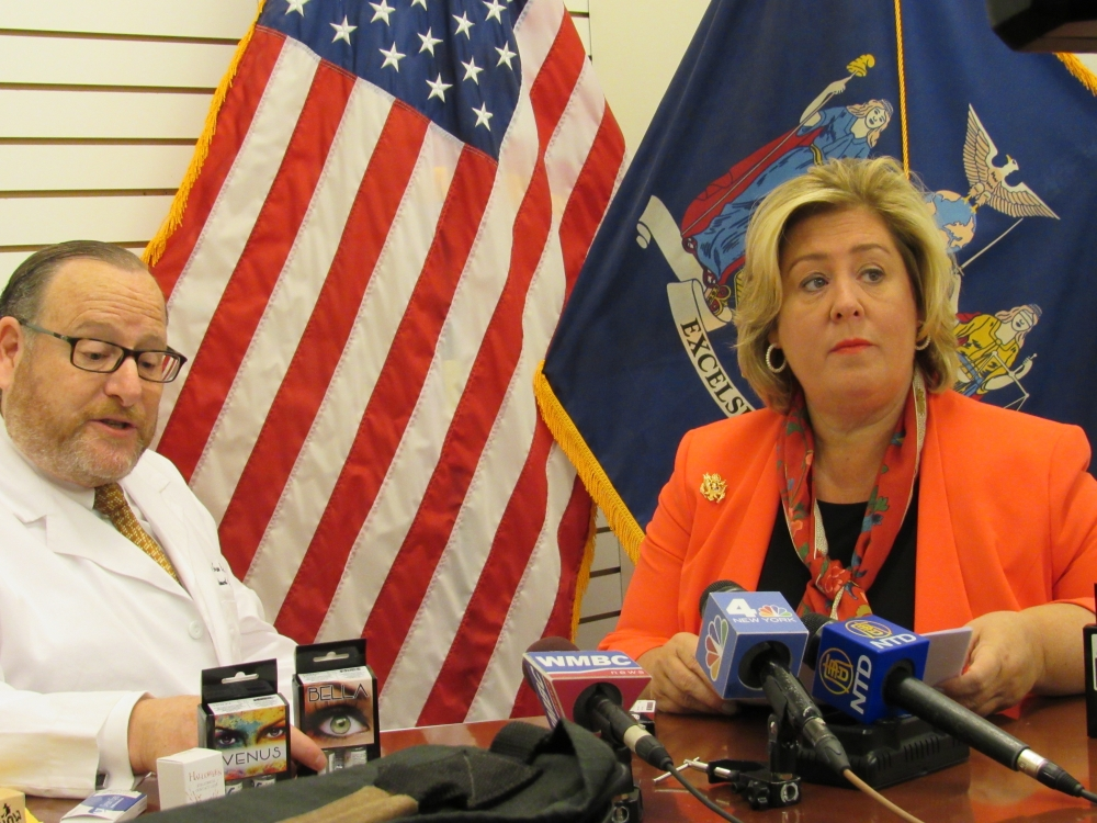 "Photo 5: On Friday, October 20, 2017 Assembly Member Rebecca A. Seawright, Chair of the Subcommittee on Consumer Fraud Protection called on her constituents and parents across New York State to ""scare with care and put safety first."" Zero power colored contact lenses are used all year-round but are most popular during the Halloween season. Dr. Dean Evan Hart, an optometrist, biologist and Director of Low Vision at Harlem Hospital Medical Center joined Assembly Member Seawright in her district community office for a press conference to warn consumers of the dangers of the popular zero power colored contact lenses sold in stores and online that can cause permanent eye damage and even blindness."