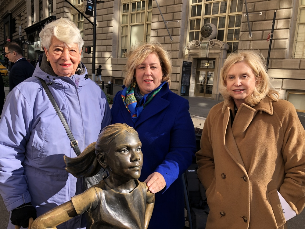 "Constituent Helene Goldfarb, Assembly Member Seawright and Congresswoman Carolyn Maloney at the Fearless Girl Statue for a press conference to build on the recent momentum for the establishment of a monumental woman monument in Central Park and call on Congress to pass Maloney's ERA bill and New York State to pass the Seawright's Equal Rights Amendment bill, <a href=""/leg/?bn=A7990&term=2017"" target=""blank"">A7990</a>, codifying equal rights for all women under our State's Constitution. <br />"