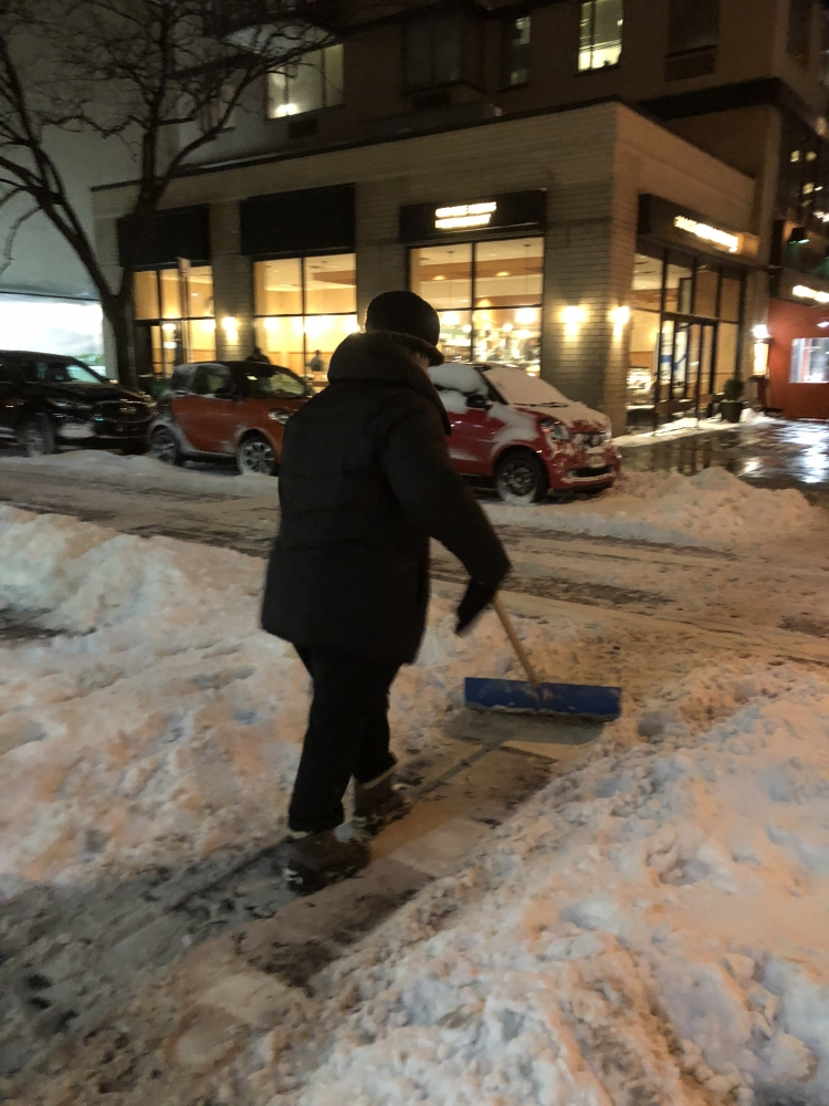 Seawright clears snow from a crosswalk on the Upper East Side.<br />