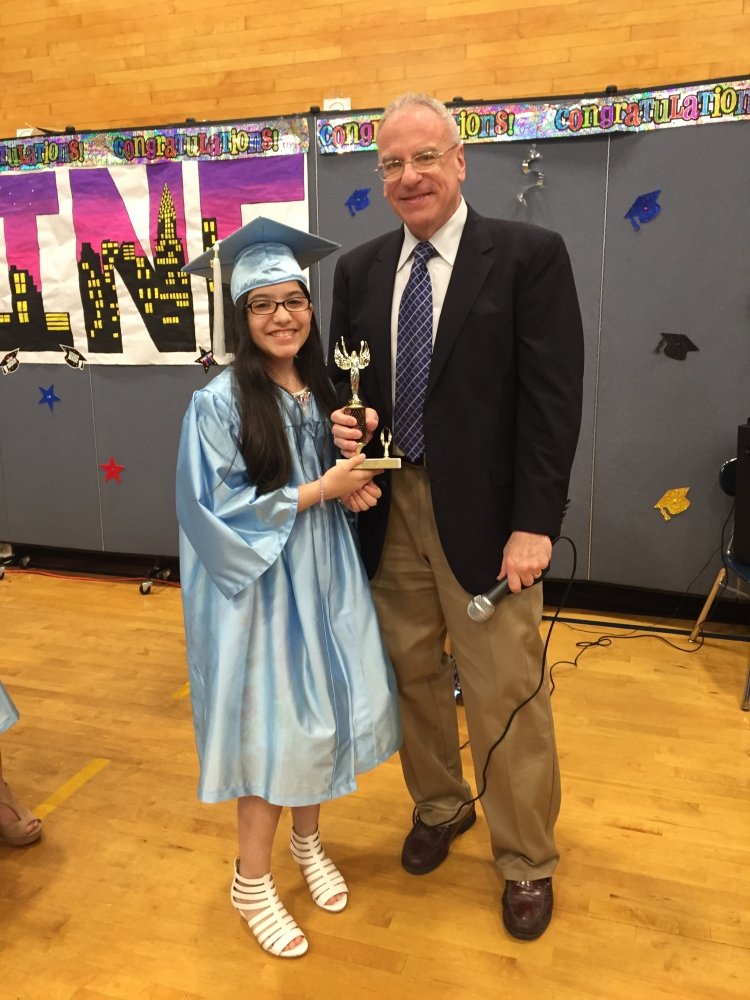 Assemblyman Dinowitz attending the June 23rd Graduation Ceremony of PS 307 and pictured here presenting the Community Service Award to Leandra Reyes.