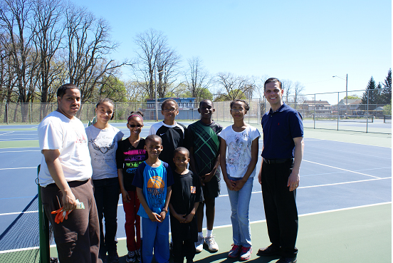 "Assemblyman Angelo Santabarbara stands with members of 15-Love at the community tennis courts on Michigan Avenue in Schenectady during ""Mt. Pleasant Neighborhood Clean-Up Day."""