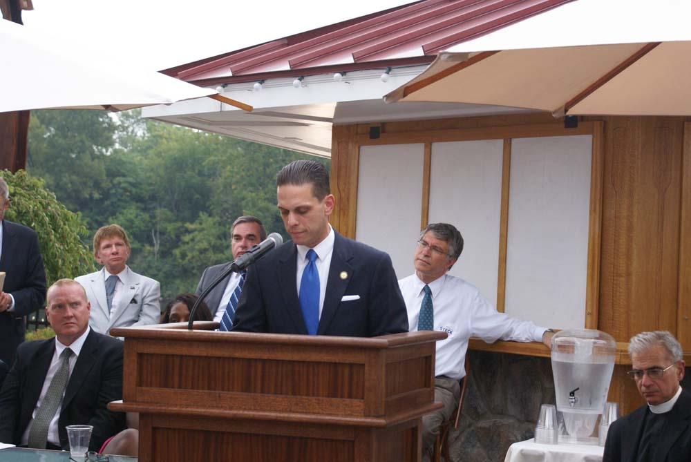 Assemblyman Angelo Santabarbara speaks to attendees at Schenectady County's 9-11 Memorial Services at the Water's Edge Lighthouse.