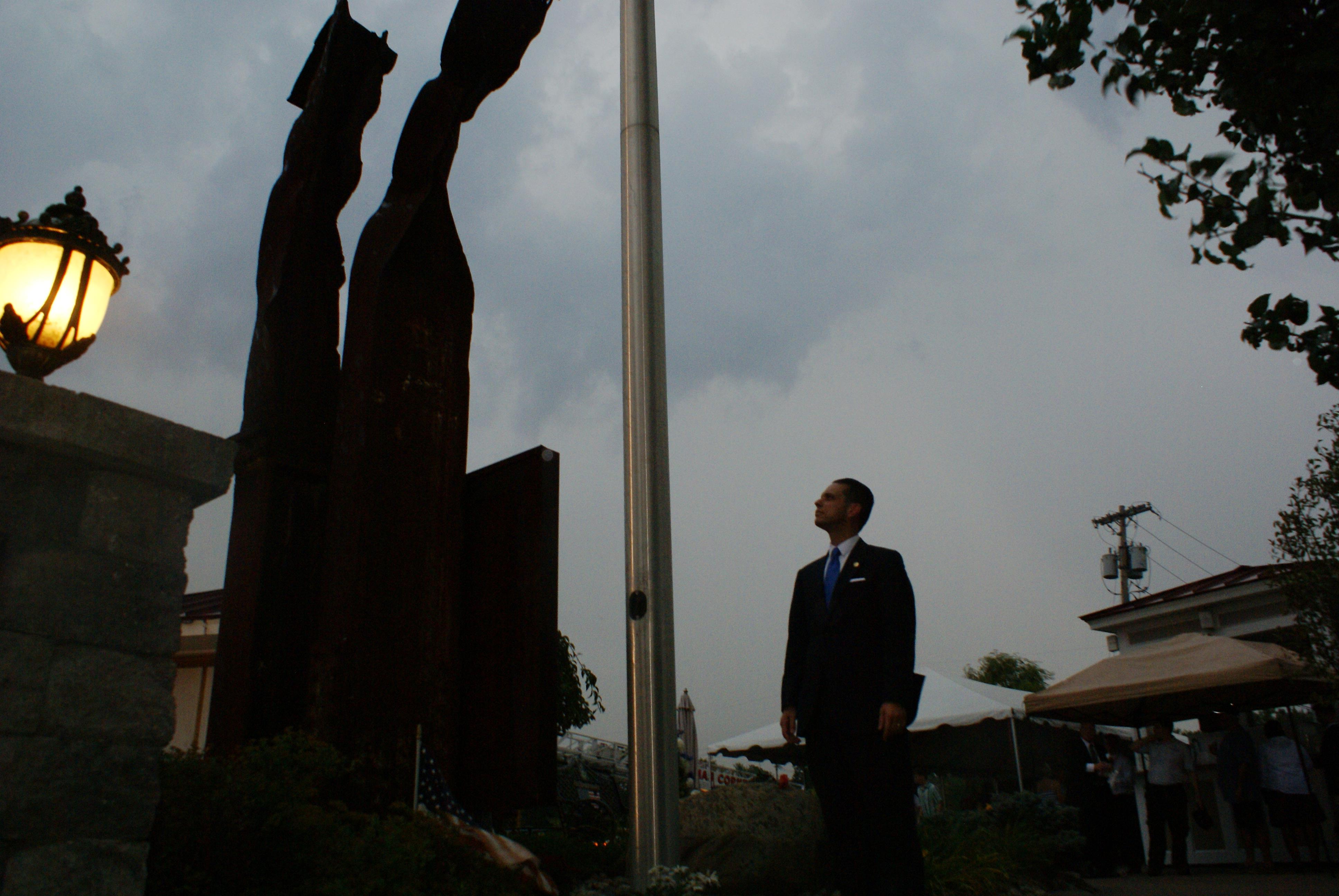 Assemblyman Angelo Santabarbara reflects while looking at the 9-11 Memorial statue located at the Water's Edge Lighthouse.