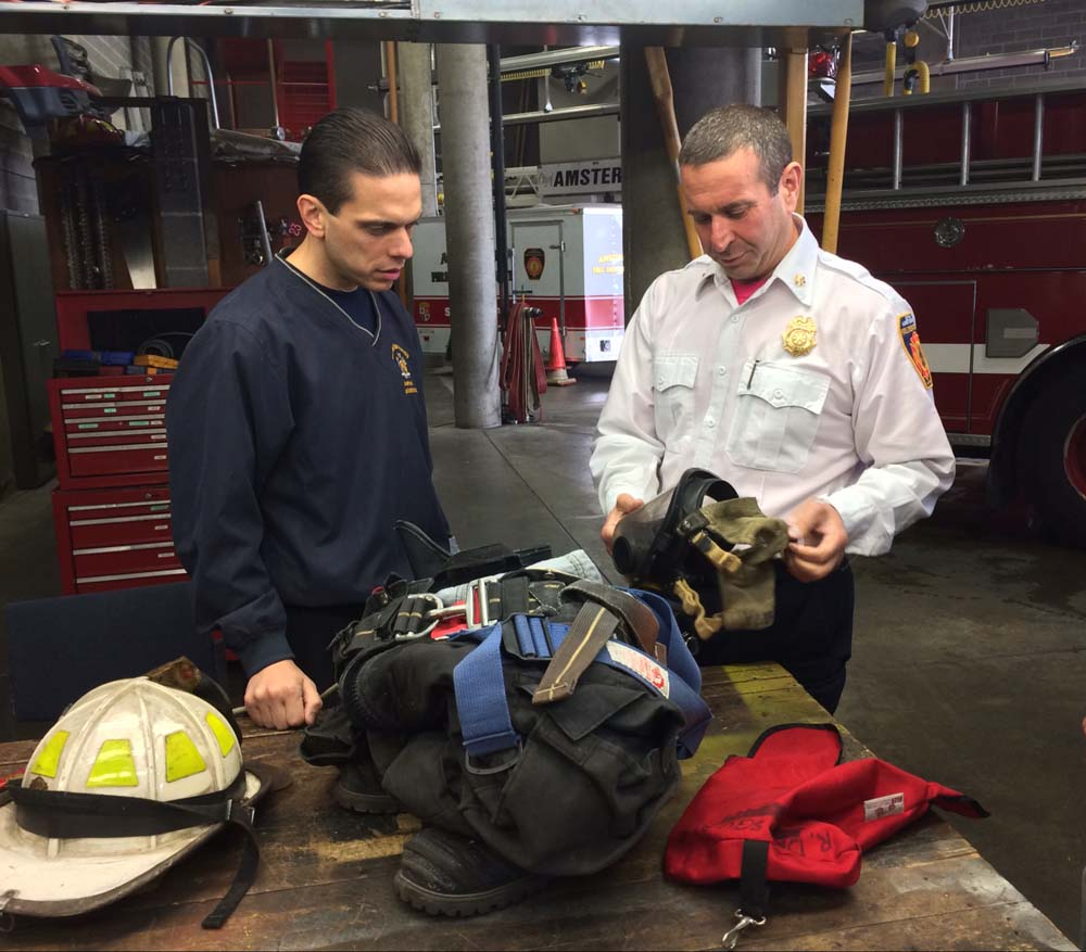 Assemblyman Angelo Santabarbara, left, visits the Amsterdam Fire Department and learns about fire safety equipment from Battalion Chief Richard Depasquale, right, on Monday afternoon.