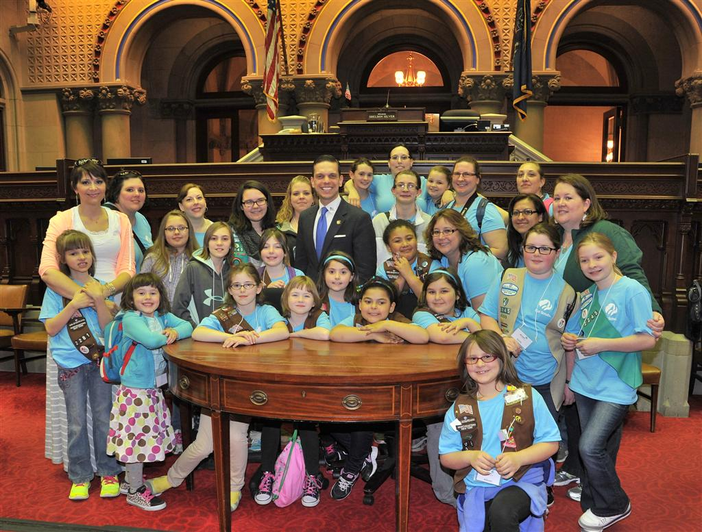 Assemblyman Angelo Santabarbara welcomes a group of local girl scouts to the Assembly Chamber.