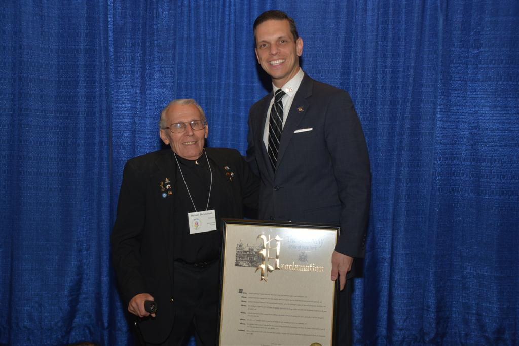 Assemblyman Angelo Santabarbara honors Richard Dickershaid, recipient of the Outstanding Contribution by a Senior Citizen Award, as a part of New York State's Senior Citizens Day.