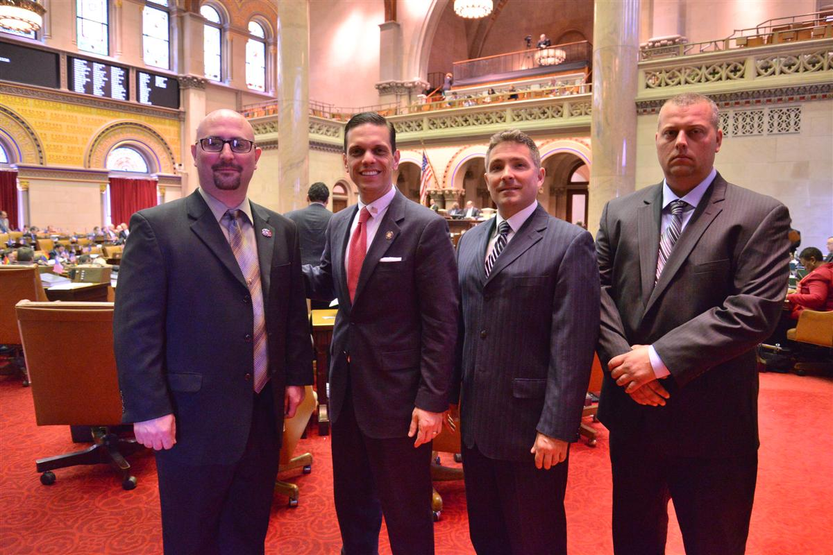 Assemblyman Santabarbara welcomes Stephen Luther of Rotterdam and representatives from the Watervliet Arsenal to the Assembly Chamber.