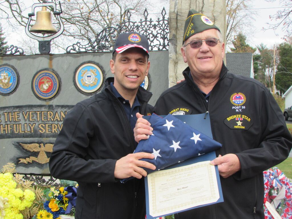 Assemblyman Angelo Santabarbara gives special recognition to Bill Hart during a Veterans Day service in Rotterdam. Hart was honored for his service in the Vietnam War as a U.S. Army medic and earning a Bronze Star Medal for heroism. 11/11/2015