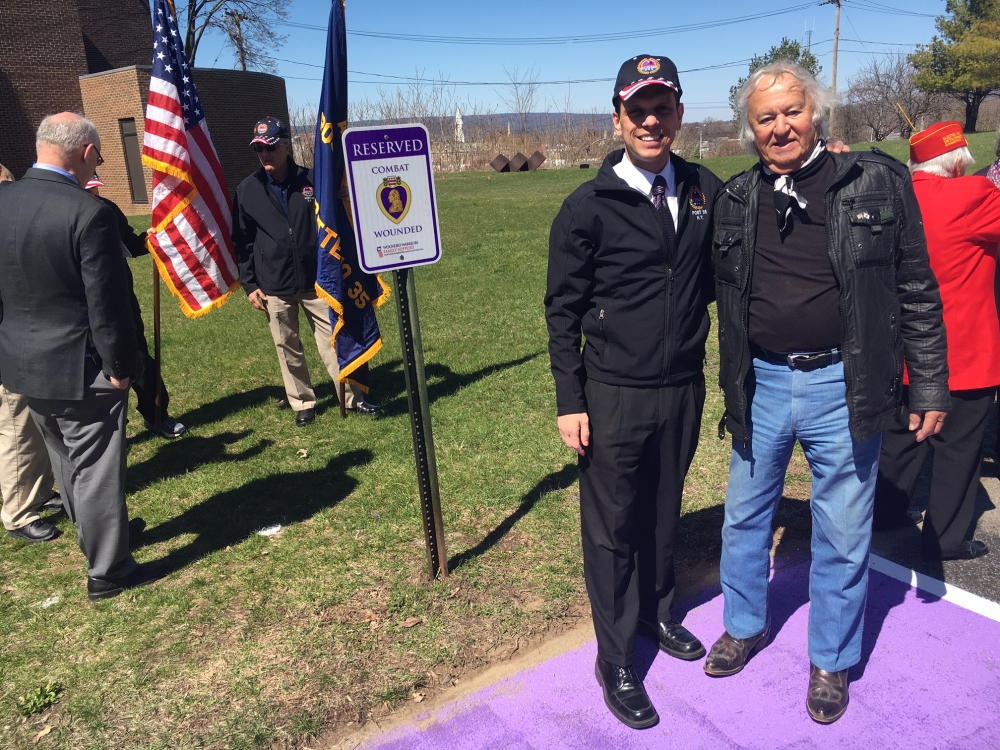Assemblyman Angelo Santabarbara poses with Princetown Highway Superintendent Nicholas Maura Sr., a Korean War Purple Heart veteran, after unveiling a Purple Heart parking space designated for veterans injured in combat.