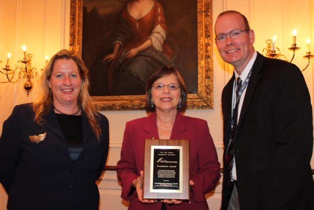 September 19, 2013 – New York Aviation Management Association President Ann Crook and Board of Directors Member Carl Beardsley present Assemblywoman Donna Lupardo with the 2013 NYAMA President's Award