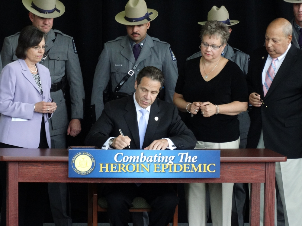 June 23, 2014: Assemblywoman Lupardo joins Governor Cuomo in Binghamton as he signs a package of bills she helped pass to combat New York's heroin epidemic.