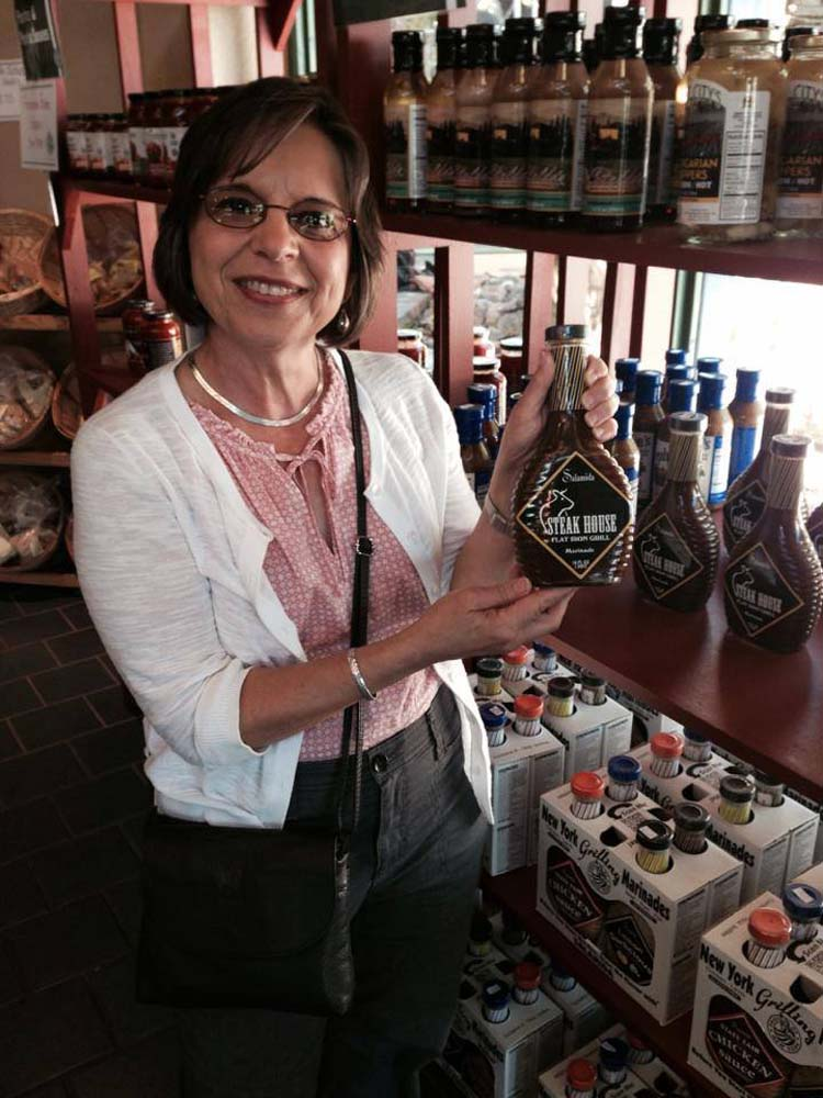 August 29, 2014 – Assemblywoman Lupardo finds a bottle of sauce for the Southern Tier's signature delicacy, spiedies, while visiting the Great New York State Fair.