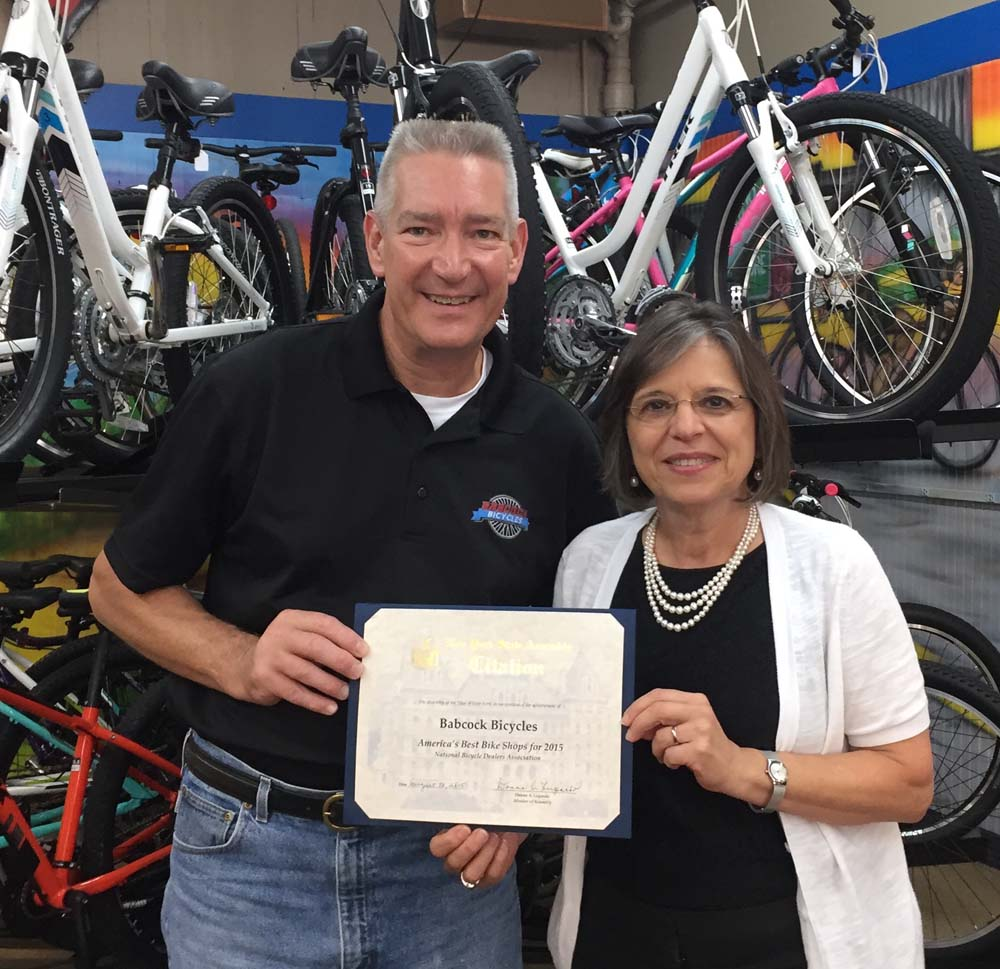 September 9, 2015 – Assemblywoman Lupardo presents the owner of Babcock Bicycles in Endicott, Kevin Babcock, with an Assembly Citation recognizing the shop as one of America's Best Bike Shops.