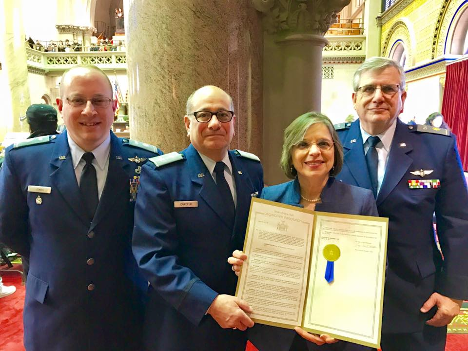 Members of New York Civil Air Patrol receive a proclamation from Assemblywoman Lupardo honoring the group's 75th anniversary.