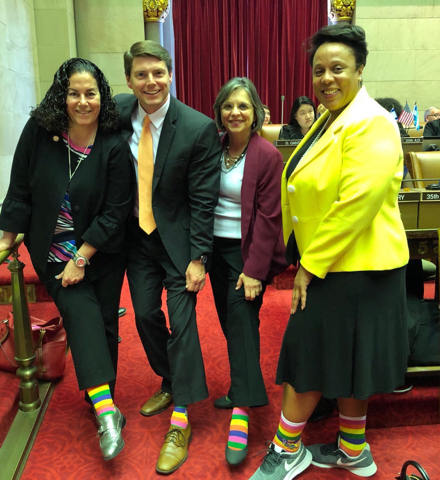 May 8, 2018 – Assemblywoman Lupardo and her colleagues Assemblymembers Pheffer Amato, Jones, and Hyndman show off their socks supporting Sock Out Cancer.