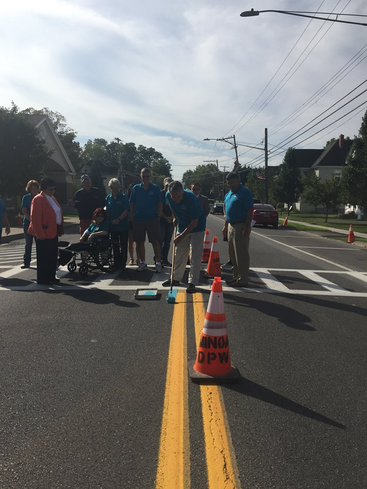 Assemblyman Al Stirpe helped raise awareness about ovarian cancer by assisting Hope for Heather in their efforts to paint the village teal in Minoa