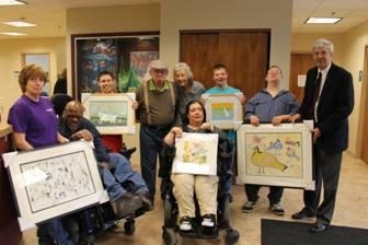 Pictured here, left to right, Terrill (Terri) Lair – Art Facilitator, Henry Wesley, Eric Barmore, Harry LaVoice, Sara Michalak – Art Facilitator, Brennan Ryel, Daniel Whitford, Eric Morrison and Assem